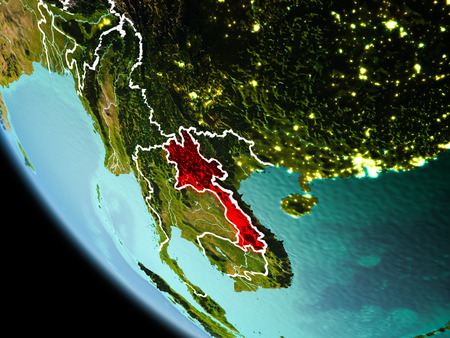Laos from orbit of planet Earth at night with highly detailed surface textures with visible border lines and city lights. 3D illustration. Stock Photo