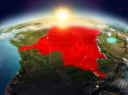 Satellite view of Democratic Republic of Congo highlighted in red on planet Earth with clouds during sunrise. 3D illustration.