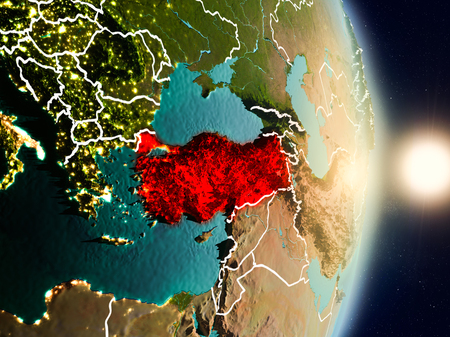 Turkey during sunrise highlighted in red on planet Earth with visible country borders. 3D illustration. Stock Photo