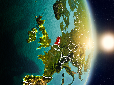 Netherlands during sunrise highlighted in red on planet Earth with visible country borders. 3D illustration.  .