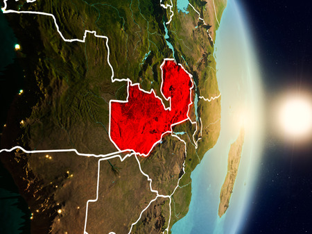 Zambia during sunrise highlighted in red on planet Earth with visible country borders. 3D illustration.