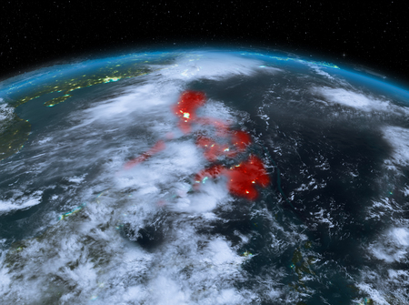 Satellite night view of Philippines highlighted in red on planet Earth with clouds. 3D illustration.