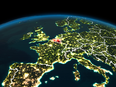 Space orbit view of Belgium highlighted in red on planet Earth at night with visible country borders and city lights. 3D illustration.