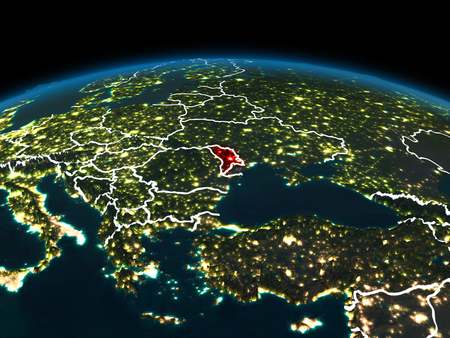 Space orbit view of Moldova highlighted in red on planet Earth at night with visible country borders and city lights. 3D illustration.