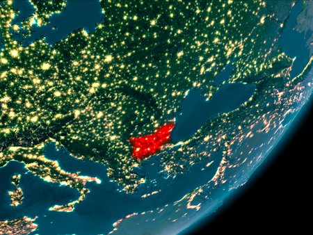 Night view of Bulgaria highlighted in red on planet Earth with atmosphere. 3D illustration. Stock Photo