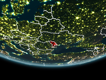 Moldova highlighted in red on planet Earth at night with visible borders and city lights. 3D illustration.
