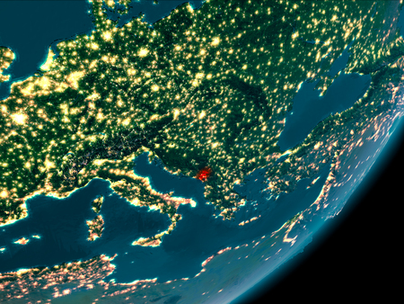 Night view of Montenegro highlighted in red on planet Earth with atmosphere. 3D illustration. Stock Photo