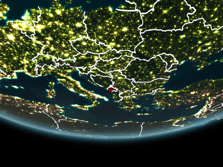 Montenegro highlighted in red on planet Earth at night with visible borders and city lights. 3D illustration. Stock Photo