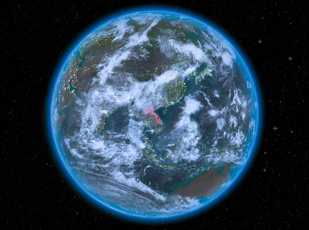 Night view of Laos highlighted in red on planet Earth with atmosphere and clouds. 3D illustration.