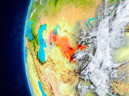 Map of Uzbekistan as seen from space on planet Earth with clouds and atmosphere. 3D illustration. Stock Photo