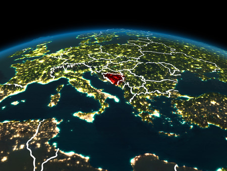 Space orbit view of Bosnia and Herzegovina highlighted in red on planet Earth at night with visible country borders and city lights. 3D illustration.