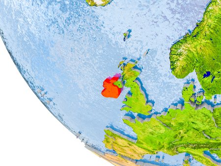 Map of Ireland in red on globe with real planet surface, embossed countries with visible country borders and water in the oceans. 3D illustration.