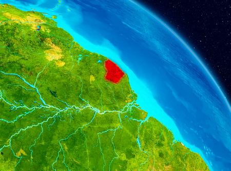 Space view of French Guiana highlighted in red on planet Earth. 3D illustration.