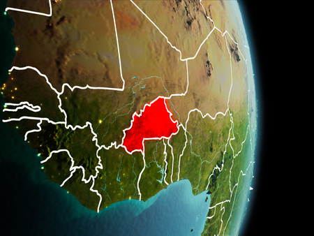 Satellite morning view of Burkina Faso highlighted in red on planet Earth with visible border lines and city lights. 3D illustration.