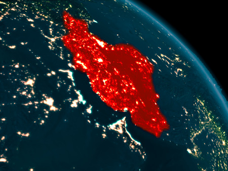 Orbit view of Iran at night highlighted in red on planet Earth with highly detailed surface textures. 3D illustration.