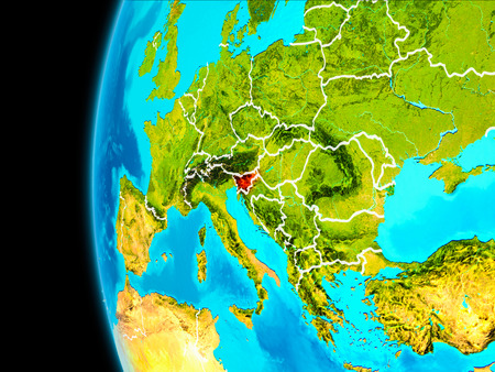 Slovenia as seen from Earth's orbit on planet Earth highlighted in red with visible borders. 3D illustration. Stock Photo