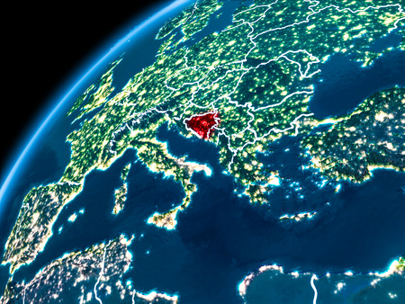 Bosnia and Herzegovina highlighted in red from Earth's orbit at night with visible country borders. 3D illustration.