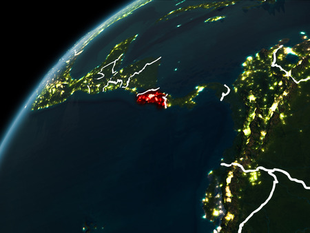 Costa Rica in red on planet Earth at night with visible borderlines and city lights. 3D illustration.