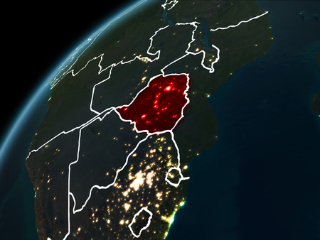 Zimbabwe in red on planet Earth at night with visible borderlines and city lights. 3D illustration.