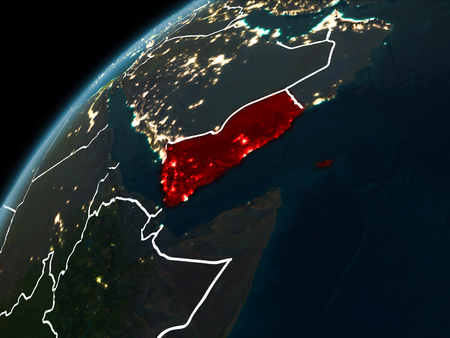 Yemen in red on planet Earth at night with visible borderlines and city lights. 3D illustration.