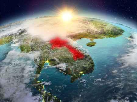 Satellite view of Laos highlighted in red on planet Earth with clouds during sunrise. 3D illustration.
