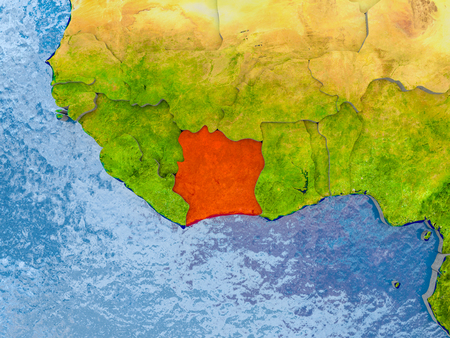 Ivory Coast in red on realistic map with embossed countries. 3D illustration. Stock Photo