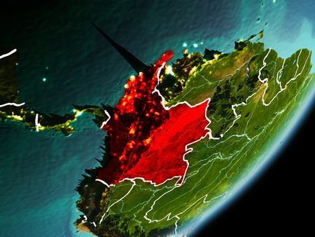 Colombia in early morning light highlighted in red on planet Earth with visible border lines and city lights. 3D illustration.