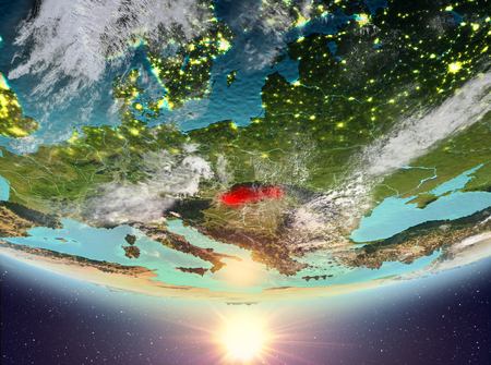 Slovakia during sunrise highlighted in red on planet Earth with clouds. 3D illustration.