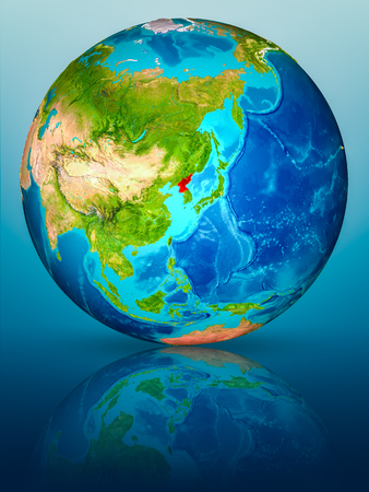 North Korea in red on model of planet Earth on reflective blue surface. 3D illustration.