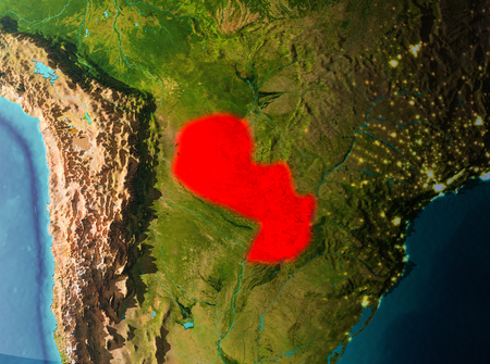 Paraguay in early morning light highlighted in red on planet Earth. 3D illustration.