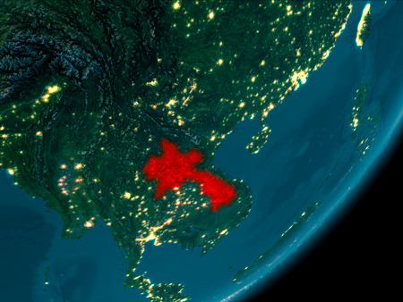 Night view of Laos highlighted in red on planet Earth with atmosphere. 3D illustration.