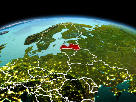 Morning above Latvia highlighted in red on model of planet Earth in space with visible border lines and city lights. 3D illustration.