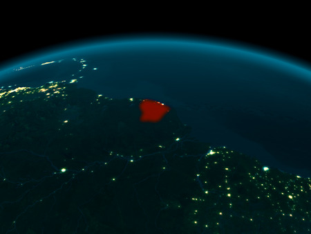 Country of French Guiana in red on planet Earth at night. 3D illustration.