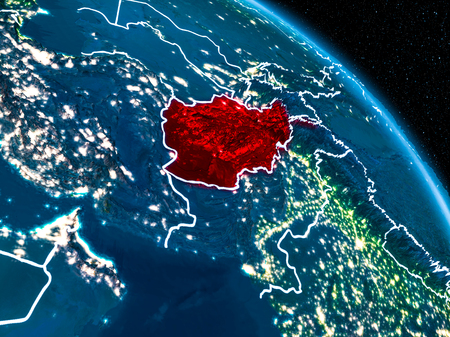 Satellite view of Afghanistan highlighted in red on planet Earth at night with borderlines and city lights. 3D illustration. Stock Photo