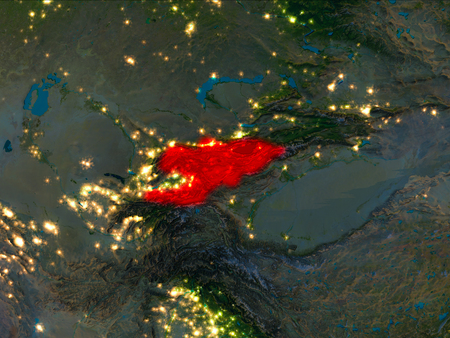 Satellite night view of Kyrgyzstan highlighted in red on planet Earth. 3D illustration.