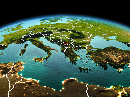 Morning above Kosovo highlighted in red on model of planet Earth in space with visible border lines and city lights. 3D illustration. Stock Photo