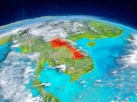 Orbit view of Laos highlighted in red on planet Earth with highly detailed surface textures. 3D illustration. Stock Photo