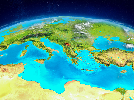 Orbit view of Kosovo highlighted in red on planet Earth with highly detailed surface textures. 3D illustration.