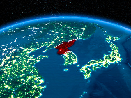 Orbit view of North Korea highlighted in red with visible borderlines and city lights on planet Earth at night. 3D illustration.