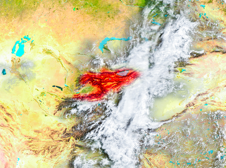 Kyrgyzstan highlighted in red on planet Earth. 3D illustration.