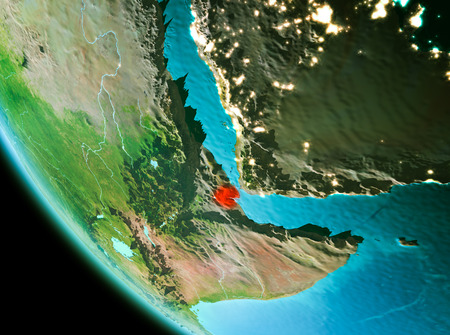 Country of Djibouti in red on planet Earth in the evening. 3D illustration.