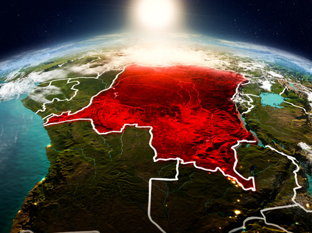 Sunrise above Democratic Republic of Congo highlighted in red on model of planet Earth in space with visible country borders. 3D illustration.