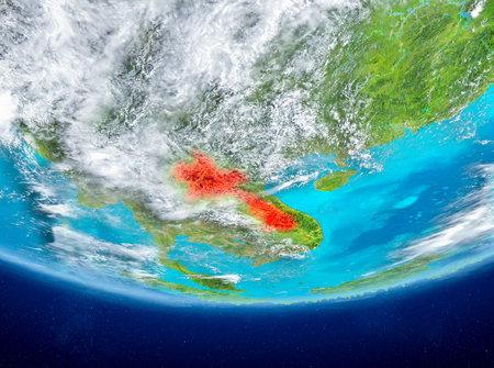 Laos highlighted in red on planet Earth with clouds. 3D illustration.