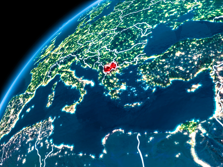 Macedonia highlighted in red from Earth's orbit at night with visible country borders. 3D illustration. Stock Photo