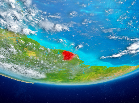 French Guiana highlighted in red on planet Earth with clouds. 3D illustration.