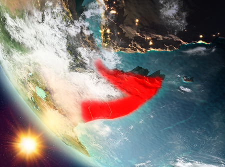 Somalia during sunset highlighted in red on planet Earth with clouds. 3D illustration.