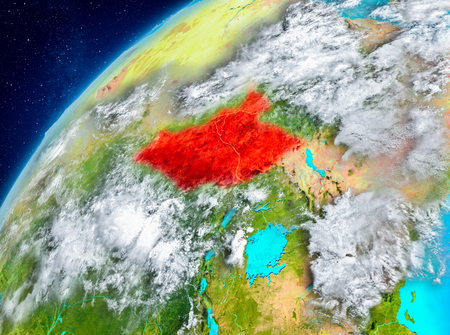 Country of South Sudan in red on planet Earth with atmosphere. 3D illustration. 스톡 콘텐츠 - 98207235