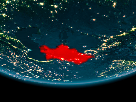 Turkmenistan at night highlighted in red on planet Earth. 3D illustration. Stock Photo