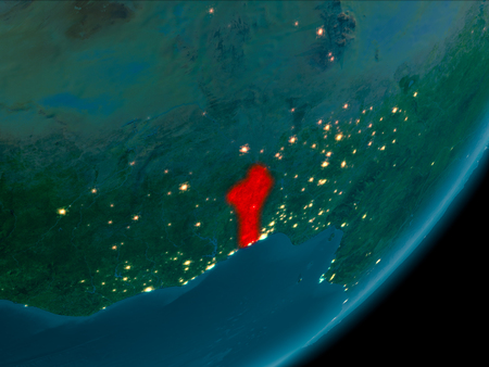 Night view of Benin highlighted in red on planet Earth with atmosphere. 3D illustration. Stock Photo