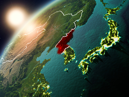 North Korea during sunset highlighted in red on planet Earth with visible country borders. 3D illustration.